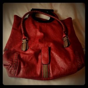 The is an red American West shoulder bag